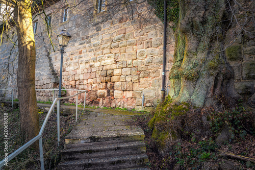 Foto Murales Footpath to an old historical building in Germany