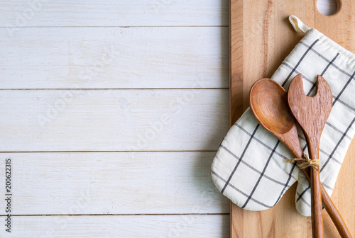 Kitchen utensils on wooden background with copy space