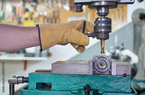 mechanic working on a milling machine