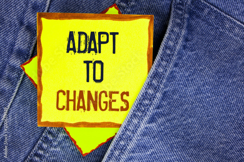 Conceptual hand writing showing Adapt To Changes. Business photo showcasing Innovative changes adaption with technological evolution written on Yellow Sticky Note Paper on the Jeans background.