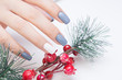 Attractive manicure on women's hands. Natural finger nails with stylish nail art.