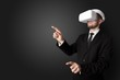 Businessman with white vr glasses in an empty room with no wallpaper