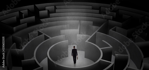 Businessman can not decide which entrance to chose in a middle of a dark maze  - 200653501