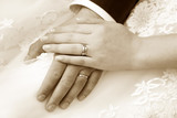 Hand of the groom and the bride with wedding rings - 200663385