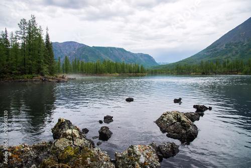 Foto op Aluminium Bergen Wonderful lake wide panorama. Scenic summer landscape, mountains and blue cloudy sky at background. Eastern Sayan, Buryatia, Russia.