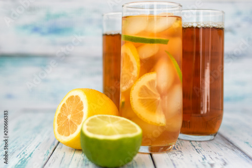 Fotobehang Sap tea with ice slices, slices of lemon and lime