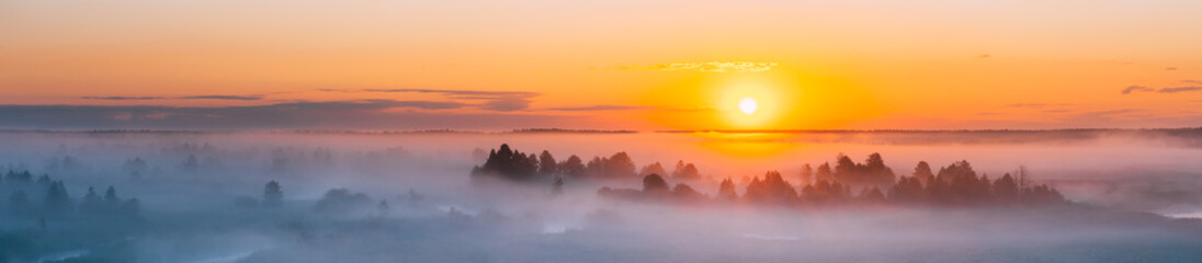 Amazing Sunrise Over Misty Landscape. Scenic View Of Foggy Morning © Grigory Bruev