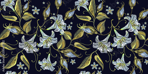 Beautiful white lillies classical embroidery on black background. Embroidery white lillies seamless pattern. Template for clothes, textiles, t-shirt design