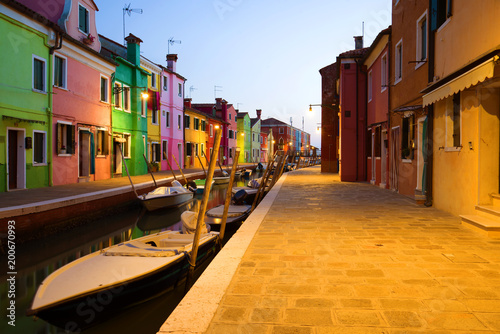Foto Murales Evening twilight on the urban canal of the Burano island. Venice, Italy