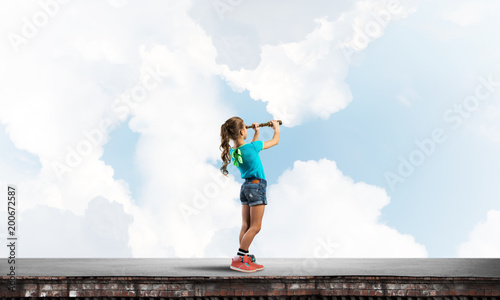 Foto Murales Concept of careless happy childhood with girl exploring this world