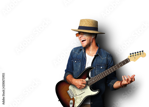 Guy listening to music and playing the guitar - 200673955