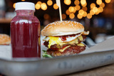 Burger and berry smoothie on metal tray - 200676105