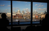 London St. Paul`s Cathedral, view from Tate Modern with Silhouetted unnamed people
