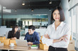 Small business entrepreneur SME freelance asian team man woman working with box, Asian small business owner at home office, delivery carry box, SME teamwork e-commerce concept