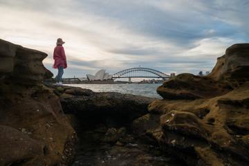 A woman views the Harbour Bridge in Sydney Australia