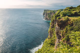 Ocean and cliff with rocks and trees in Bali - 200706158