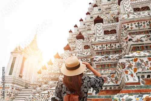 Sticker Woman tourist is sightseing inside Wat Arun's Pagoda in Bangkok, Thailand.