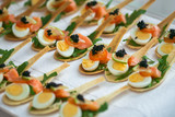 Delicates, appetizer filling with red fish, quail egg, black caviar and lime. Catering service. - 200729129