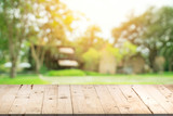 Empty wood table and defocused bokeh and blur background of garden trees in sunlight, display montage for product. - 200730386