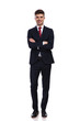 happy businessman standing with arms folded