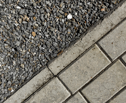 Crushed stone and pavement tiles. Urban background. Combined - 200738567