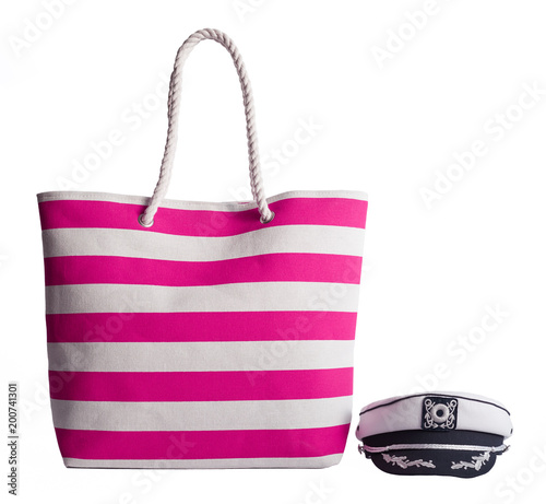 aaa20d815cf Pink stripe beach bag and captains hat isolated on white background ...