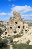 Cappadocia: Ancient  rock dwellings carved into natural volcanic rock formations in  the cappadocian landscape at Goreme