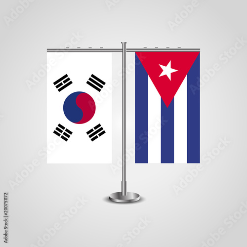 Table stand with flags of South Korea and Cuba.Two flag. Flag pole. Symbolizing the cooperation between the two countries. Table flags