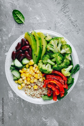 Aluminium Boeddha Healthy buddha bowl salad with grilled vegetables. Quinoa, spinach, avocado, beans, sweet corn, broccoli, cucumbers and paprika