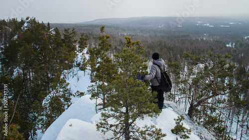 hiker at mountain trail in winter day