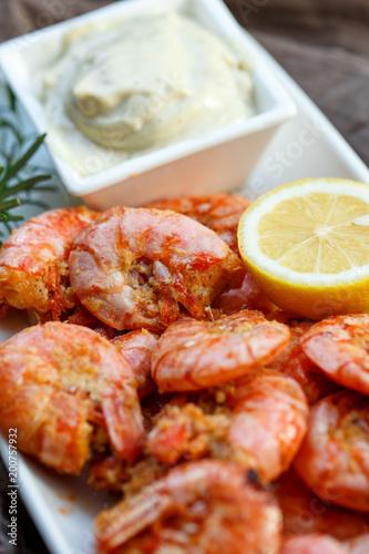 row tiger shrimp with lemon on brown