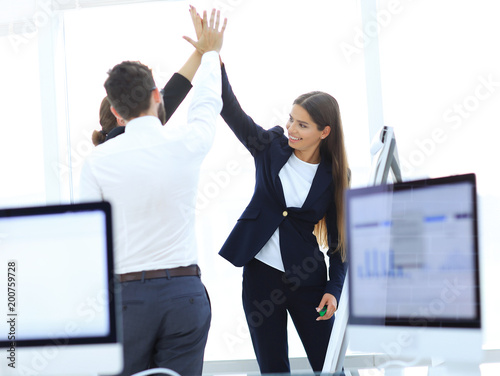 closeup.business team, giving each other a high five