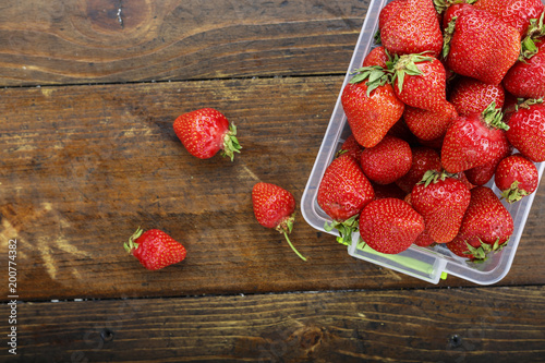 ripe strawberry in a plastic container