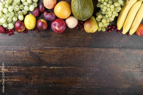 exotic fruits on a wooden background