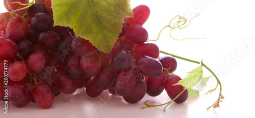 Fresh grapes isolated .