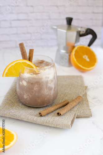 Foto op Canvas Milkshake Chocolate-vanilla mousse with an orange slice on a white marble table