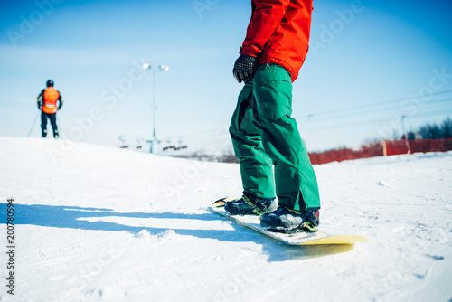 Foto Murales Snowboarder riding a snow hill, extreme sport