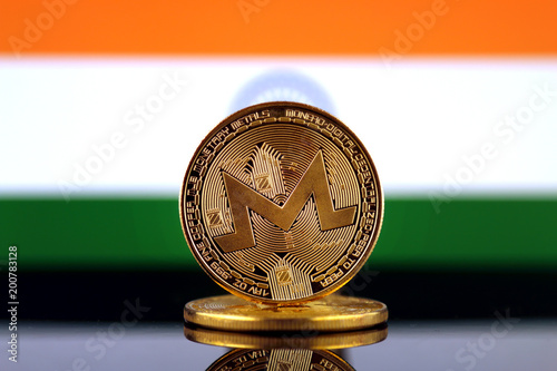 Foto Murales Physical version of Monero (XMR), new virtual money and India Flag. Conceptual image for worldwide cryptocurrency and digital payment system. Studio shot.