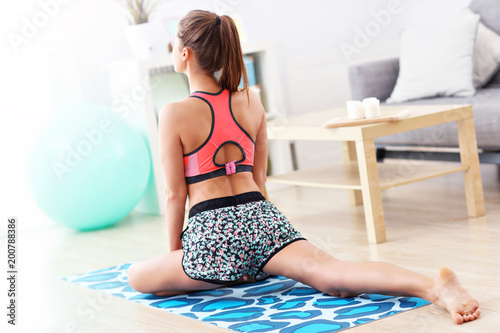 Woman doing fitness exercises at home
