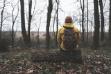Man with backpack in wild forest. Travel and adventure concept. Landscape photography