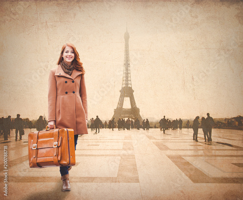 Wall mural Redhead woman with suitcase come to Paris for conquer
