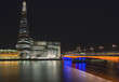 Beautiful London City skyline landscape at night with glowing city lights and iconic landmark buldings and locations