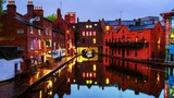 Birmingham, UK. Embankments during the rain in the evening at famous Birmingham canal in UK. Cloudy blue sky. Time-lapse at night - 200791506