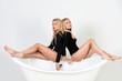 Relax, spa, bathroom, bodycare. twin women in bath, relations.