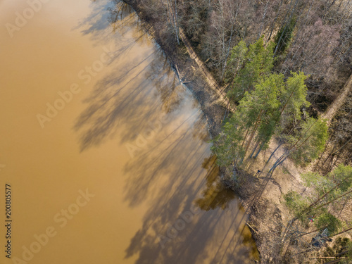 Foto Murales drone image. aerial view of forest river in spring. Gauja, Latvia