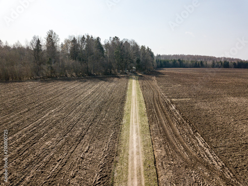 Poster Wit drone image. aerial view of wet cultivated agriculture fields near Jaunpils in Latvia