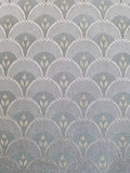 close up of old and faded upholstery fabric abstract design