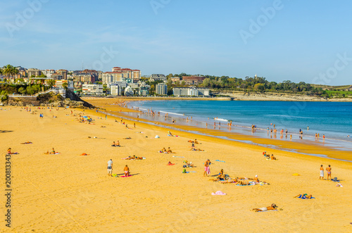 Tuinposter Oranje View of a beach in the spanish city Santander