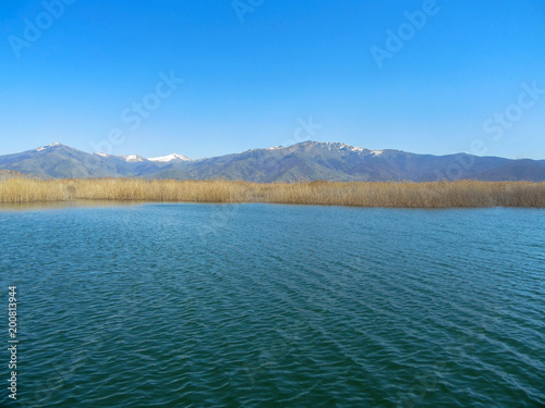 Plexiglas Groen blauw Landscape of Little Prespa Lake, Municipality of Devol, Greece.