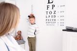 Cute little boy measuring height in hospital